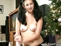 Festive babe gets her tits out to tug